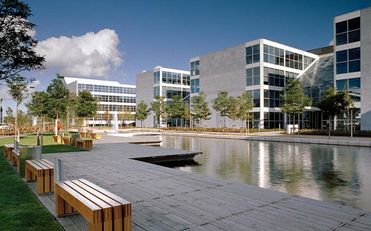 Exterior of office buildings with a large pond