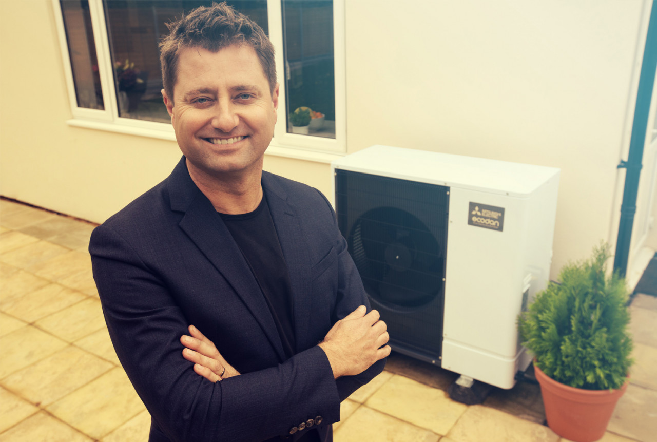 George Clarke standing next to Ecodan in a garden